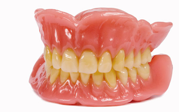 How can we stabilise loose dentures?